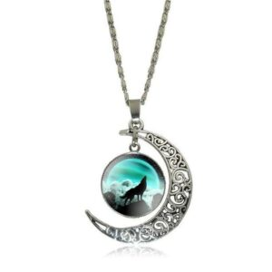 crescent moon cabochon necklace with a wolf howling at the moon