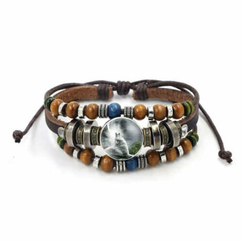 Leather wolf cabochon bracelet showing an artic wolf howling protected by glass made of leather, beads and steel
