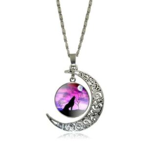 wolf necklace crescent moon with a wolf howling at the moon in a pink cabochon