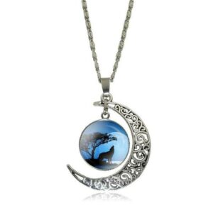 Howling wolf necklace with a pendant with a crescent moon and a cabochon showing a wolf under a tree