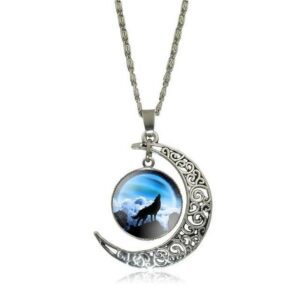 necklace showing a wolf howling at a blue moon embeded in a crescent moon