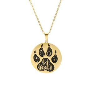 Wolf paw necklace gold and black with a wolf howling at the moon in a forest