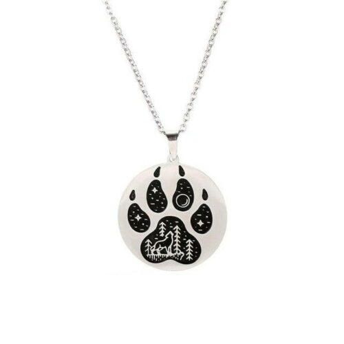 wolf paw necklace steel showing a wolf howling at the moon